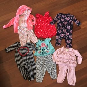 Array of 6-12 month old girls' clothing
